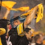 Pittsburgh Steelers fan waves his TerribleTowel while the rain comes down in Pittsburgh