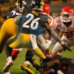 Pittsburgh Steelers running back Le'Veon Bell (26) making a cut in the backfield during the game.