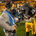 Pittsburgh Steelers running back Le'Veon Bell (26) autographs the NBC game ball after the game.