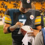 Pittsburgh Steelers quarterback Ben Roethlisberger (7) autographs the NBC game ball after the game.