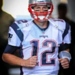 New England Patriots quarterback Tom Brady (12) running out of the tunnel before the start of the game.