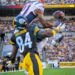 New England Patriots cornerback Malcolm Butler (21) goes up high to intercept a pass intended for Pittsburgh Steelers wide receiver Antonio Brown (84) during the first half.