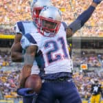 New England Patriots cornerback Malcolm Butler (21) celebrates after coming up with an interception in the end zone during the first half.