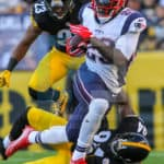 New England Patriots running back LeGarrette Blount (29) running through an attempted tackle from Pittsburgh Steelers inside linebacker Lawrence Timmons (94) during the game.