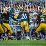 Pittsburgh Steelers quarterback Landry Jones (3) hands the ball off to Pittsburgh Steelers running back Le'Veon Bell (26) during the game.