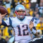 New England Patriots quarterback Tom Brady (12) looking for an open receiver during the game.