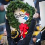 A Pittsburgh Steelers fan is in the holiday spirit with a custom Pittsburgh Steelers sign.