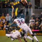 Pittsburgh Steelers tight end Jesse James (81) leaps high and above Baltimore Ravens cornerback Tavon Young (36) andBaltimore Ravens free safety Lardarius Webb (21) after catching the ball.