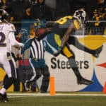 Pittsburgh Steelers running back Le'Veon Bell (26) leaps into the end zone for a touchdown during the second half.